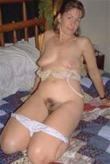 hairy wife on her bid and flashes both her tits and hairy pussy for us ...