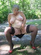 Exposing Granny Shows Her Naked Body Outdoors
